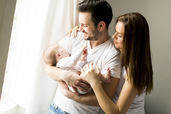 Happy couple with newborn